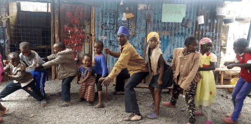 PRF founder trustee Dominic having fun with Kahawa Soweto slum needy children after event